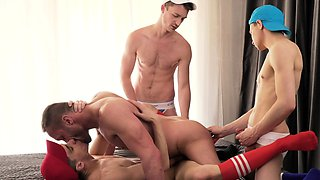 Muscular daddy gangbanged by four hung twinks