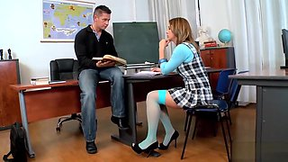 Hot schoolgirl takes care of a stiff shaft