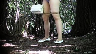 Charming amateur wife in pantyhose pissing in the outdoors