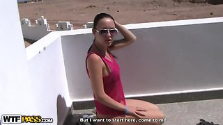 Hot and sensual brunette in bikini gives head in public