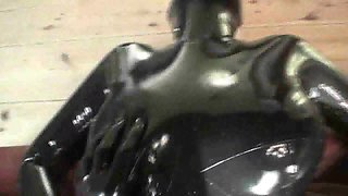 Sweet girl gets fucked through ripped rubber suit