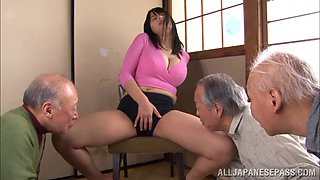 Bosomy Japanese babe exposes her muff to the old men to tease it with a vibrator