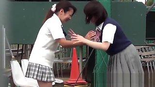 Naughty Japanese schoolgirls pissing in secret public place